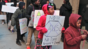 "Dvorak Elementary students protest a proposal to ""turnaround"" their school outside the March 26 Board of Education meeting. (Flickr/Bob Simpson)"